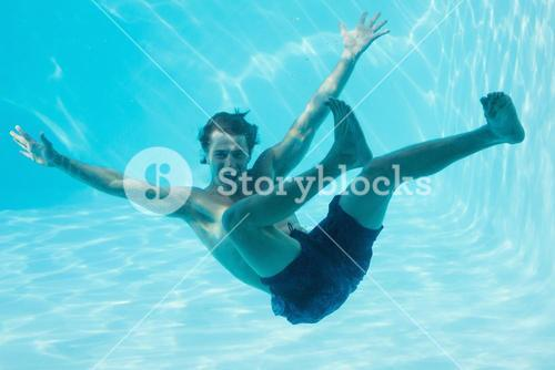 Young man swimming underwater