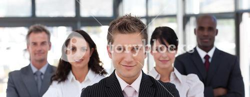Beautiful business team looking at the camera