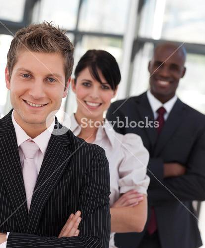 Cheerful business team looking at the camera
