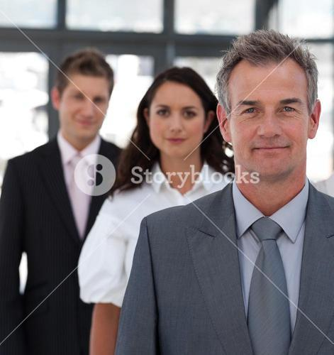 Portrait of a selfassured business team looking at the camera