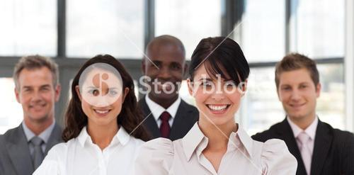 Portrait of several business people looking at the camera