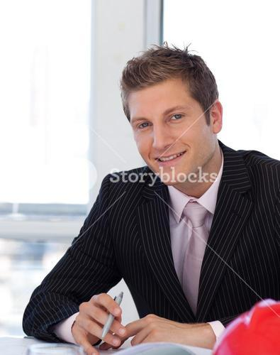 Joyful businessman working at his desk