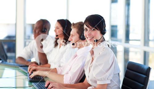 Portrait of a relaxed sale representative team at work