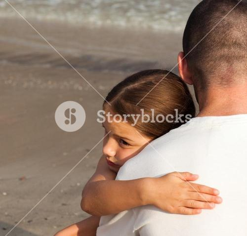 Portrait of a cute Daughter Hugging his father