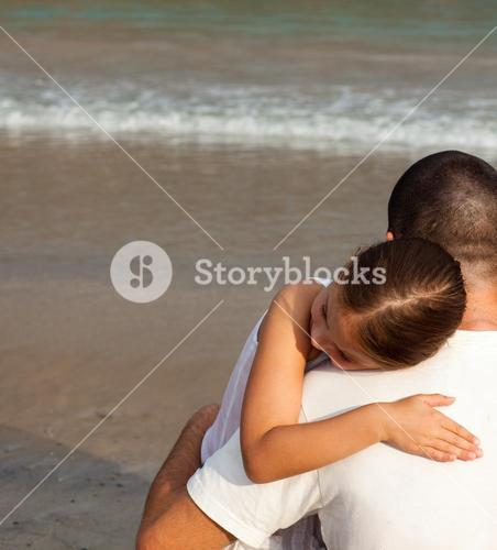 Portrait of a relaxed Daughter Hugging his father