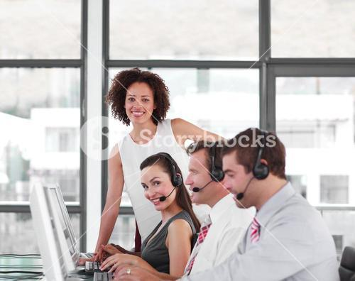 Serious female manager with her sale representative team