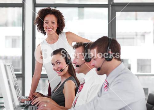 Selfassured female manager with her sale representative team