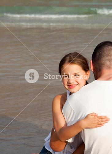 Portrait of a smiling Daughter Hugging his father