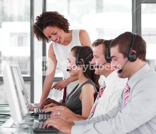 Confident female manager with her sale representative team