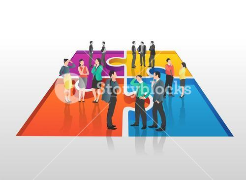 Business people standing on jigsaw piece