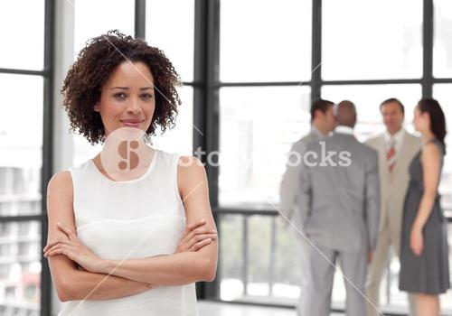 Businesswoman arms folded with his colleagues