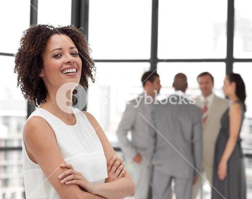 Confident Businesswoman arms folded with his colleagues