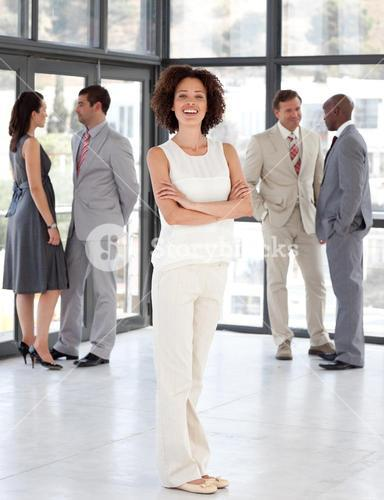 Cute Businesswoman arms folded with his colleagues