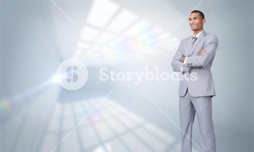 Composite image of charismatic attractive businessman with folded arms