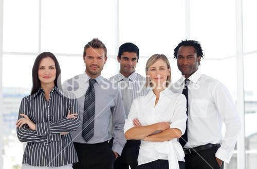 Portrait of a cute group of business people looking at the camera