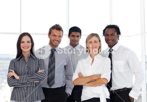 Portrait of a happy group of business people looking at the camera
