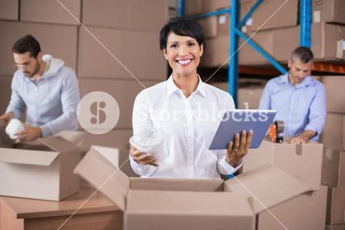 Warehouse workers packing up boxes