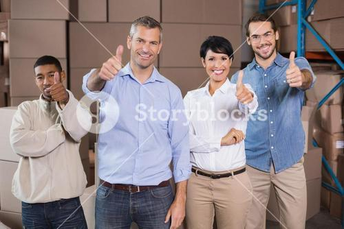 Warehouse workers smiling at camera