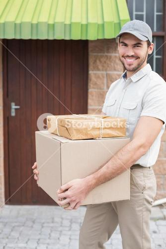 Delivery driver walking with parcels