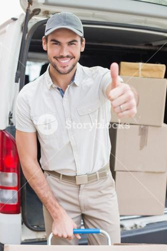 Delivery driver loading his van with boxes