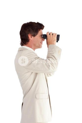 Selfassured businessman with binoculars