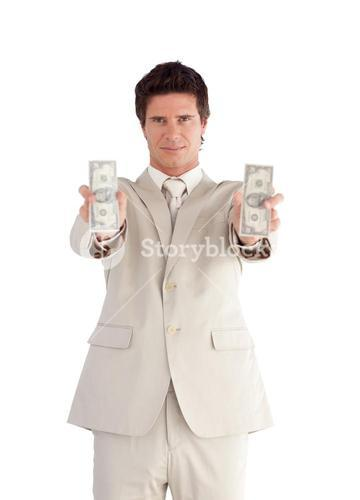 Selfassured Businessman holding Dollars