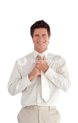 Welldressed happy businessman looking at the camera