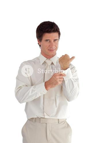 Welldressed confident businessman looking at the camera