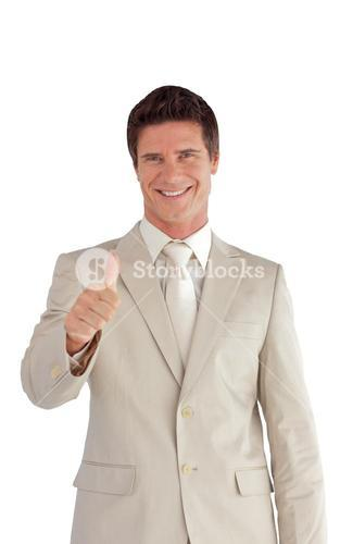 Successful businessman making a thumbup