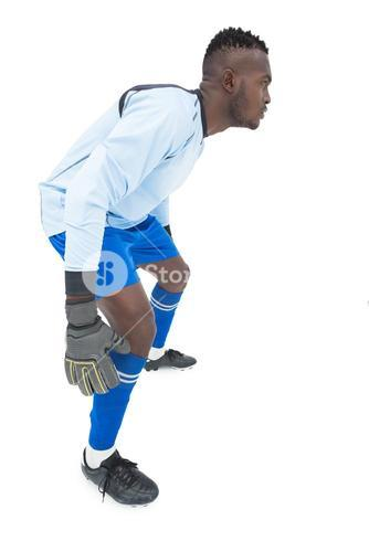 Side view of a concentrated goal keeper