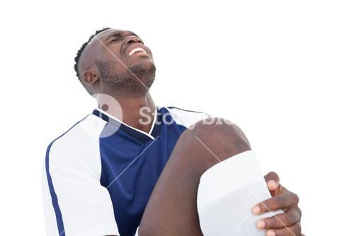 Soccer player shouting in pain