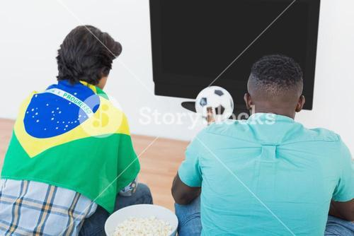 Brazilian soccer fans watching tv
