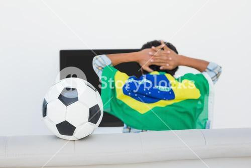 Brazilian soccer fan watching tv