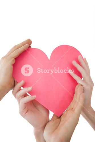Close up of hands holding heart