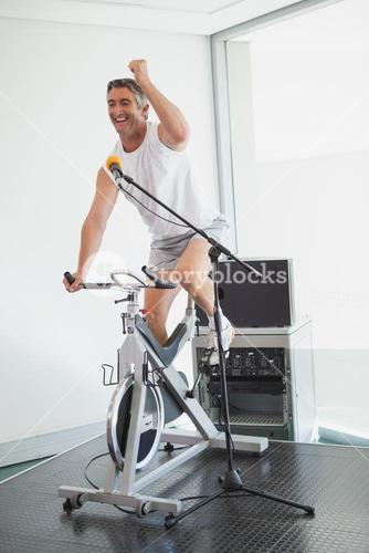Spinning instructor motivating his class