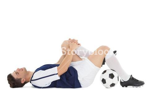 Soccer player lying down in pain