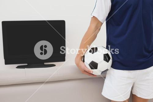 Soccer fan watching tv