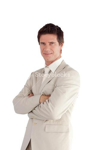 Positive businessman standing at the camera
