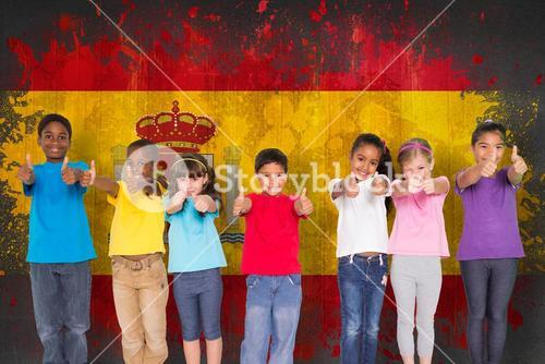 Composite image of elementary pupils smiling showing thumbs up
