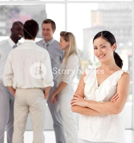 Diverse people talking together at work