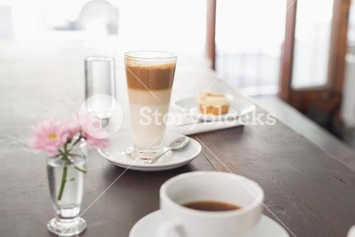 Latte and coffee on table