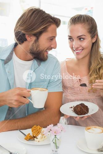 Happy couple enjoying coffee and cake