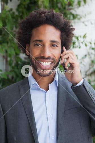 Handsome businessman on the phone