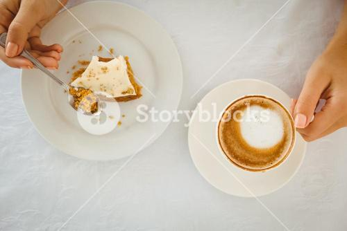 Woman having cake and coffee