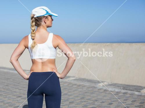 Fit blonde standing on the pier