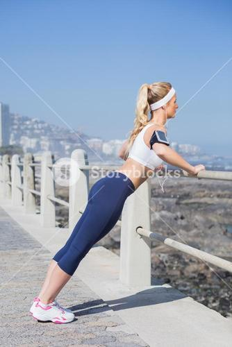 Fit blonde listening to music