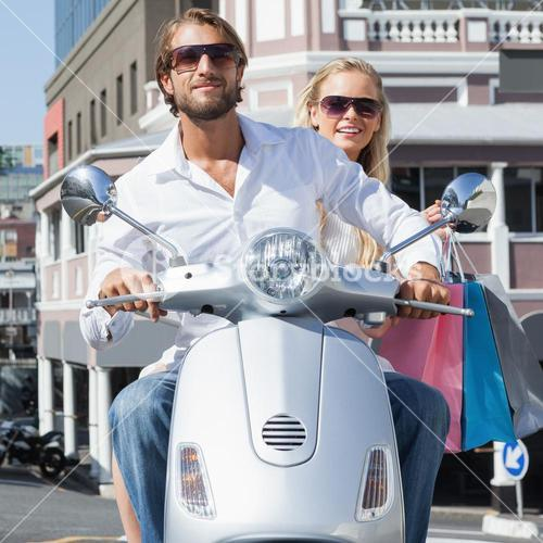 Cute couple riding a scooter