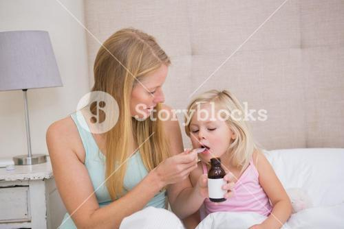Cute sick girl being looked after