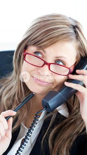 Thougtful confident businesswoman wearing red glasses