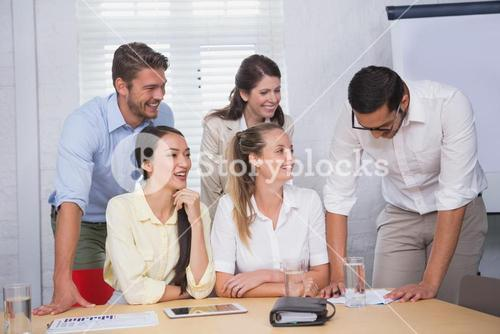 Happy business people working together on a document